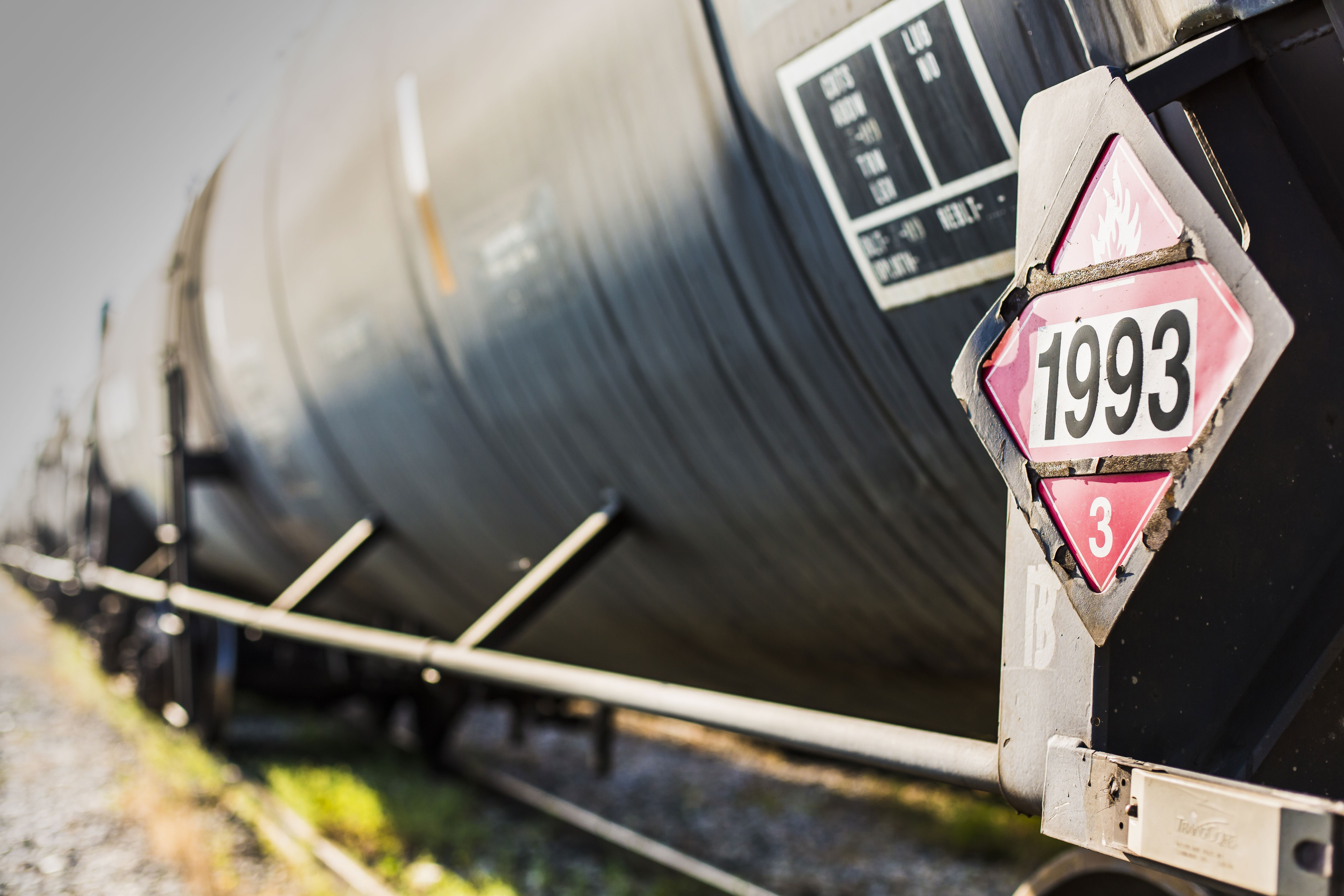 Railroad tanker with placard