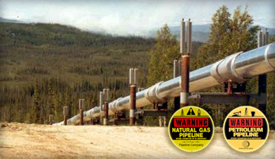 Picture shows pipeline along with warning labels attached