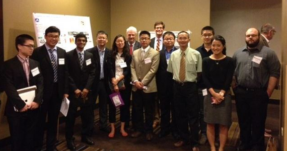 Students and Principle Investigators line up for photo after the Student Poster Paper Session at the 2014 R&D Forum